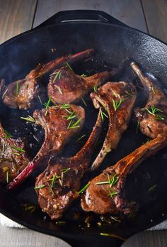 Easy lamb lollipops with garlic and rosemary, seared in a cast iron skillet.
