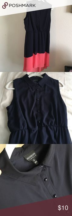 "Navy blue and coral dress size 12 Sleeveless collared button top dress. Navy blue and coral colored. Elastic waist. Fully lined. Shoulder to hem: 36"". Back is longer with additional length approx 5"" sheer.100% polyester Enfocus Dresses"