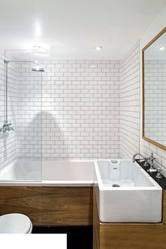 Awesome White subway tiles in a small bathroom are crisp, classic and space-enhancing, and look particularly on trend with grey grout. The post White subway tiles in a small bathroo . Wood Bathroom, Bathroom Renos, Grey Bathrooms, Bathroom Layout, Bathroom Interior, Bathroom Storage, Bathroom Mirrors, Wood Tub, Bathroom Pink