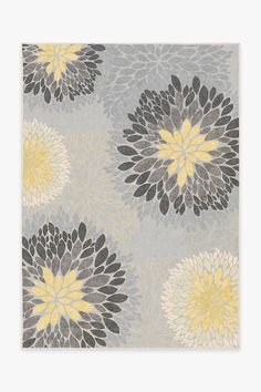 This brightly colored floral rug features a medallion design in dandelion yellow and grey. Waterproof, stain-resistant and machine washable. Free Shipping!