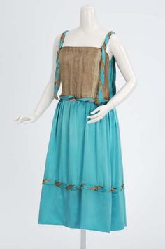 1920-1925 Blue satin evening dress with gold trimming. Attributed to dressmaker Jenny Lee Gowns, Minneapolis, Minnesota.