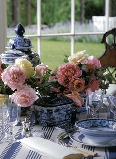 roses in blue and white china