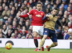 Arsenal's Francis Coquelin clears the ball under pressure from Manchester United attacker Memphis Depay