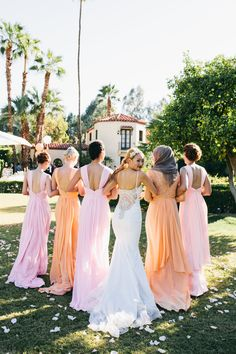 Colorful and unique bridesmaid dresses. Pink and orange bridesmaid dresses. Different style dresses.  | Palm Springs Wedding | Lovelyfest Event Design
