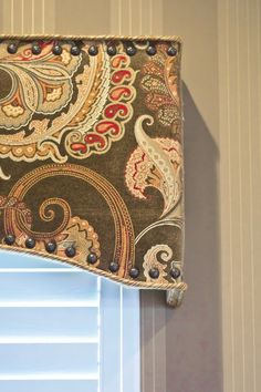 It's the little things that make a difference, like the nailhead trim on this cornice.