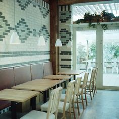 A Scandinavian-Influenced Cafe in Japan (with a Bit of LA, Too) Gardenista. Painted brick pattern. An interesting solution for an old mantle. Bold & creative.