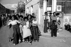 Group of girls standing on the corner at Notting Hill Carnival, London, 1975