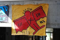 groepswerk rasteren: keith haring - acrylverf op bruin papier Reinhilde Debruyne