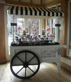 This Essex based company specialise in bringing something a li?ttle bit different to your special wedding day event by bringing along their stylish candy cart with lots of delicious nibbles for your guests to enjoy. Candy Table, Candy Buffet, Stage Patisserie, Candy Bar Vintage, Bar Deco, Sweet Carts, Ice Cream Cart, Candy Cart, Flower Cart