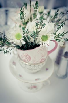 Florals in pink and white teacups for an Alice in Wonderland wedding!