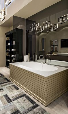 Bathtub from the Manhattan bathroom collection by Oasis, with Edge suspension lamp from the Lighting collection.