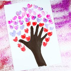 Fingerprint Heart Valentines Day Tree craft for Kids. Using fingerprints & hands, kids will love this simple art process to make art or DIY Valentine's Day Card