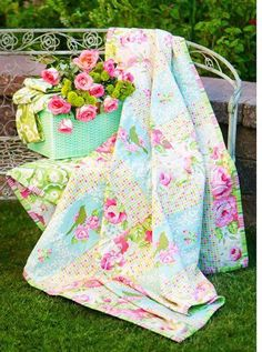 ...rosy quilt and lovely flowers in pretty basket.