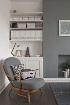 Keeping storage all one colour, adding a mid century style chair and witty cushions make for a great, contemporary look in a subtle sea of grey and white.