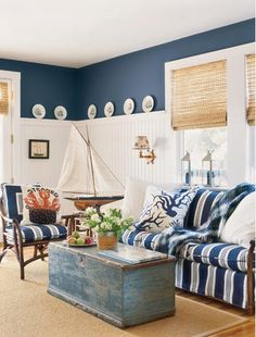 Love the painted trunk, wainscoting & paint color.
