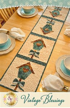 "Vintage Blessings Table Runner - March Pattern: Decorate your home all year long with a beautiful Vintage Blessings Table Runner by Jennifer Bosworth of Shabby Fabrics. This pattern is for the March design. Table Runner measures approximately 12 1/2"" x 53""."
