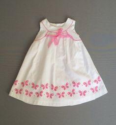 Vestido blanco con mariposas y lazo rosas