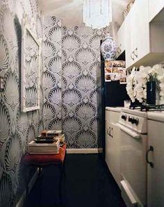 wallpapered galley kitchen