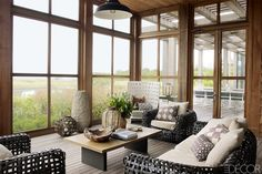 """The homeowners were sure of one thing going in: The house would have to have a split personality. They wanted it to be formal on the street side and entirely beachy at the back. """"The idea was to seem like Fire Island out the back doors,"""" says the wife, referring to the legendary barefoot, car-free beach community some 50 miles away. She wanted the kids to be able to run wild in an environment decked with textured surfaces and sturdy structures. """"I wanted it to be a little camp-like, as…"""