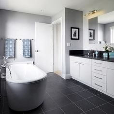 """Benjamin Moore's HC-169 Coventry Gray works marvelously with stark white cabinetry and black countertops."""""""