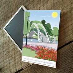 The Suspension Footbridge, Bedford Embankment Magnet  £3.00  The Suspension Footbridge found on Bedford Embankment is now depicted on a magnet.  Designed by myself and professionally digitally printed and constructed in the UK. Magnet is packaged in branded packaging making it the perfect gift or treat for yourself! Dimensions: 5.5 x 8 cm