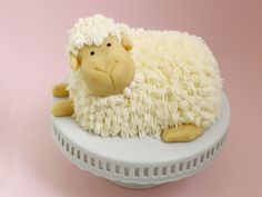 Learn how to make an adorable buttercream-piped lamb cake with this step-by-step guide.