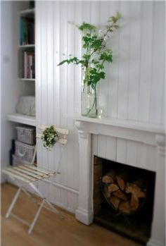 love the green leaves contrasting with the white wall