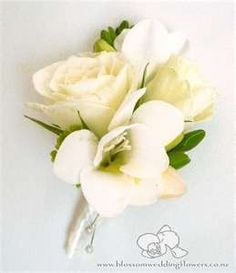 The family corsages will be ivory spray roses and white freesias wrapped in ivory ribbon.