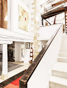 Lofty, spacious foyer and staircase in white building