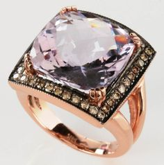 Cushion cut light pink gem surrounded by forty diamonds measuring approximately .01 carats each, stamped mark of 14k, ring size 6 and weight of 16 grams.  Provenance: The Joseph Candioto Trust.   We ship in-house for all items with the exception of very large and or very fragile pieces and some international shipments.