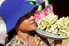 Girl selling sticky rice in Cambodia