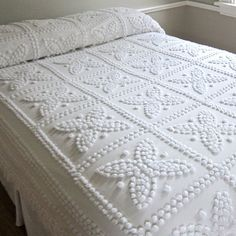 Vintage chenille bedspread in snowy white, with fringe