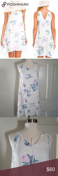 MinkPink Floral Drop Waist Dress Mink Pink Floral Drop Waist Dress is in a size S. This white floral dress is tiered with a keyhole back. Perfect lightweight dress for summer.   This dress is 100% Viscose. It is 16 in armpit to armpit, 26 in armpit to bottom. MINKPINK Dresses
