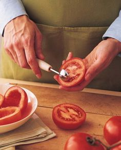 Remove seeds more efficiently from a tomato using a melon baller instead of a knife.