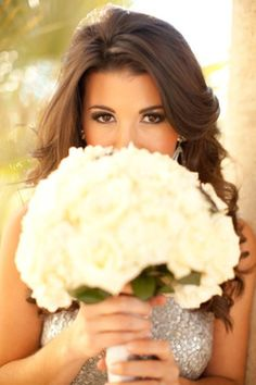 bridesmaids : silver dress, white flowers