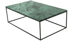 Marmorbord med svarta metallben och svävande design