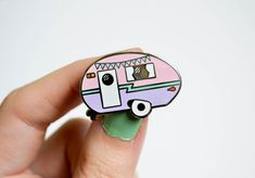 The sweetest retro camper enamel pin! This lapel pin features silver nickel plating with pastel coloured hard enamels and a rubber clutch. It