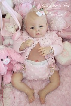 reborn baby doll in pink