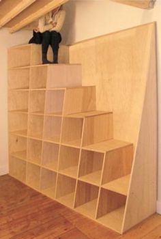 Great idea for Stairs and Storage in a shop with a loft of attic storage.  Even a great setup for cats (shop cat) to have a place to climb and play!
