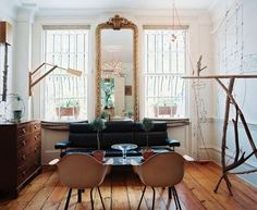 I like the mirror between the two windows (the rest I don't care much for).  http://www.apartmenttherapy.com/small-living-rooms-with-style-168783?utm_source=feedburner_medium=feed_campaign=Feed%3A+apartmenttherapy%2Fmain+%28AT+Channel%3A+Main%29_content=Google+Reader