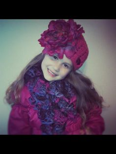 My girl wearing my hand crocheted hat and ruffle scarf!