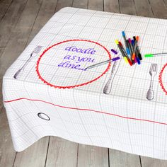 They less table clothes that you can doodle on at amazon.  Maybe get white or colored linen and have sharpies for people to doodle on? It'd even be cute if they were all different types, for entertaining people, and maybe only allow doodling on a couple tables?