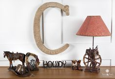 This beautiful rustic Large Cowboy Wall Letter is the perfect finishing touches to a boys western themed room. The letter was hand wrapped with twine and finished off with 2 metal cowboy hats at the top edge of the letter.