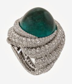 James Currens Tropical Storm ring with 22.10 carat emerald surrounded by diamonds