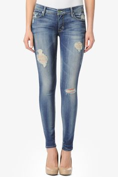 """Our Krista Super Skinny combines a super slimming 10"""" leg opening with a regular rise to perfectly hug the bum and thighs. You'll love the Krista in Blondie, a light blue wash with distressed details in our 360° stretch fabric with maximum retention and recovery so that your jean doesn't lose its shape."""
