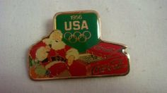 1956 Coca Cola Christmas Olympic Pin by Oohlala Company. $12.99. 1956 Coca Cola Christmas Olympic pin. This pin, along with other dated Coca Cola Christmas Olympic pins, was made to sell around the 1984 Olympics. Rare to find!
