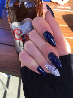 A set of Navy blue and sparkle stiletto nails