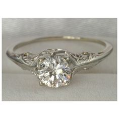 Vintage wedding ring. I like the ornate but simple band and single diamond, and again I like how round it is, I don't like square or halo rings. This is my favorite ring that I've seen.