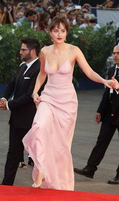 Dakota Johnson sports Bally Eren heels in silver to the premiere of Black Mass at the Venice Film Festival