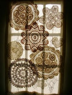 A curtain made of muslin and crocheted doilies adorns a door . . . let the sun shine in!!